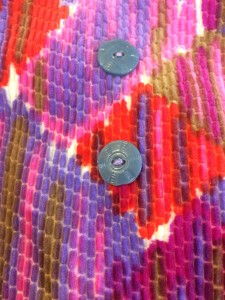 Button detail at front